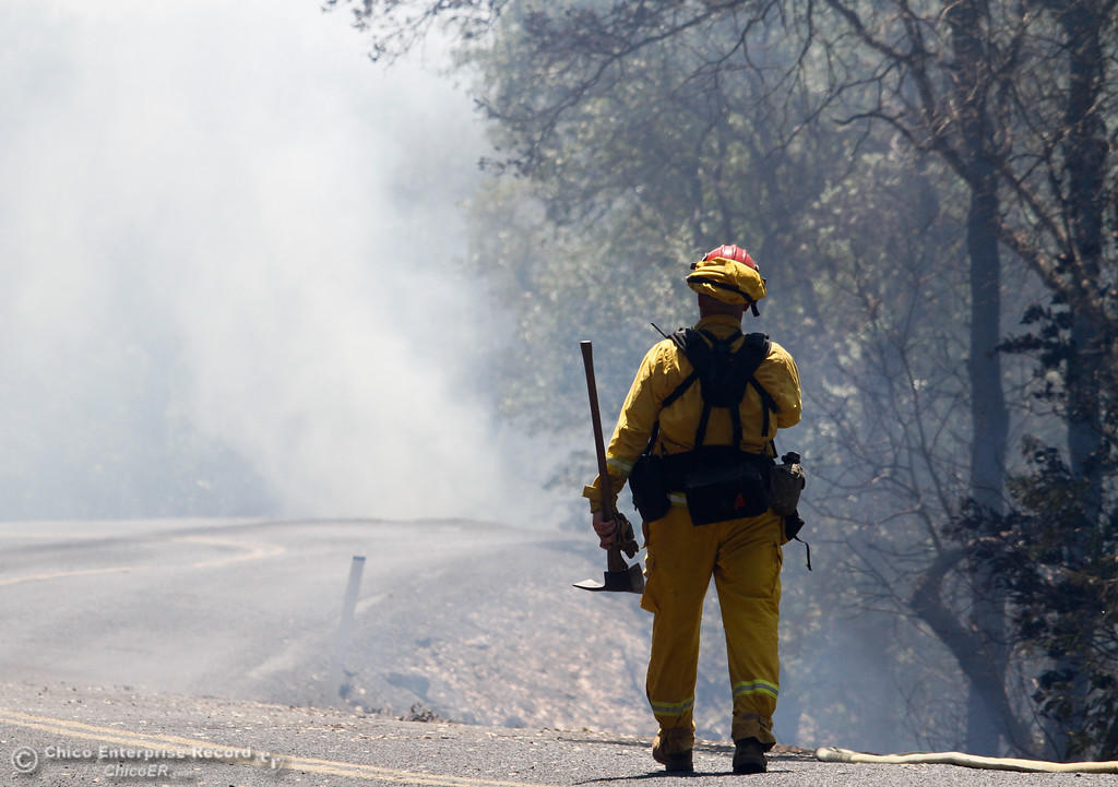 . A firefighter heads into a cloud of smoke as the Wall Fire reaches 5,000 acres Sunday July 9, 2017 in Oroville , California.  (Emily Bertolino -- Enterprise-Record)