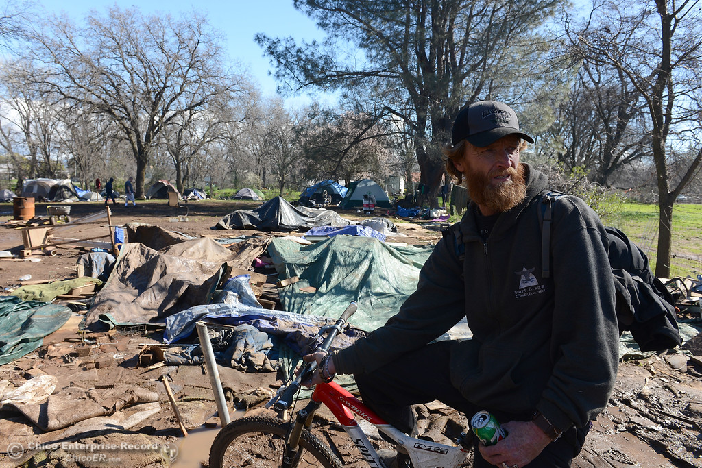 . Larry Robison talks about cleaning up what he can after about half of the people living at a homeless encampment had left Thursday, Feb. 23, 2017, with the remaining cleaning what they could before being evicted from the site on the 2600 block of Notre Dame Boulevard in Chico, California. (Dan Reidel -- Enterprise-Record)
