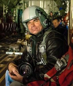 Photographer Rich T. Slattery inside a USAF C-130