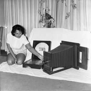 This is a photo that I usually have of my Mother in the photo exhibits that I do on the road.  I just like it.  It shows this (now) antique photo copier.  My Dad was one of few experts that could copy a picture (that is if somebody did'nt have the negative and wanted a copy say in a larger size).  See where that dollar bill is?  They used that to get the copier into focus and then slide the new frame into the back with the picture.  We have saved a lot of our very old grand parents and other older photos that way of our family.  Now, they have copiers and scanners.  Technology.  But if it needed to be done back in the day, Dad knew how to do it.  My Mother knew how to do the oil painting like on Senior Photos.  Have you ever seen one of those older, say from the 1950/60's that was color but didn't really look like a real color photo?  That's because it wasn't.  It was black & white and oil painted.  The only thing I remember my Mother saying was the hardest part of oil painting a Senior Portrait was the eyes but she always did a beautiful job.  We still have my brothers portrait from 1966.  That was definitely an art.  There were only 2 people in our area that did it.  My Mom & another woman who used to help us sometimes.  Her last name was (sp?) Shimophining.  Mom also did most of the phone work, addressing envelopes, & thru the 60's, she & my father developed and printed  there own black & whites & even taught me (their daughter) how to.
