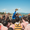 """Coach Jay Jay is starting something new with the school kids to address the huge trash problem in Walukuba.  """"Let's Play Green"""" is an initiative where children must clean up the entire playing field before participating in sports.  Jay Jay uses the opportunity to teach the children about the environmental & health problems associated with improper trash disposal.  Because this is linked with sport - something fun - there will be a positive association with picking up trash.  The children will also bring this back to their other friends and family, educating the rest of the community."""