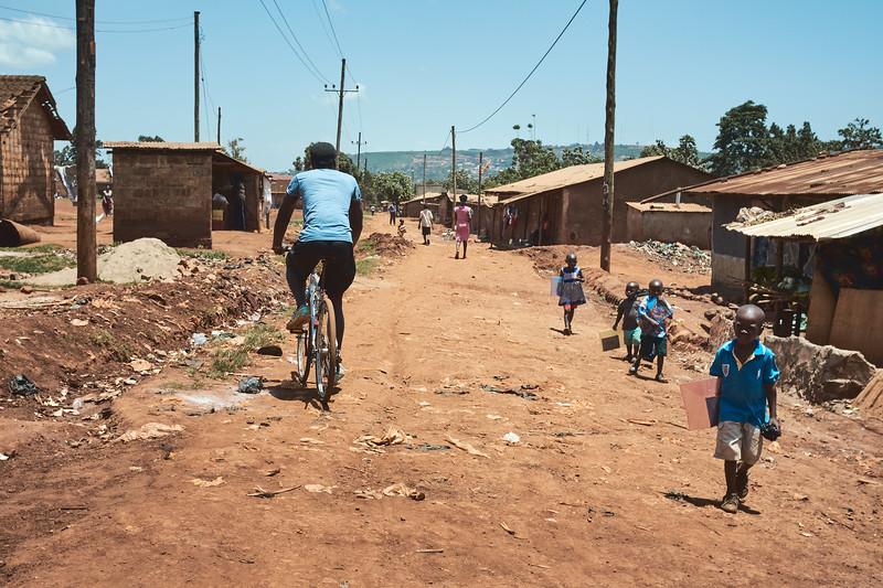 Typical street in Walukuba as children walk home from school.