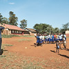 Jakob, an X-SUBA intern from Germany, leads children in soccer drills before playing a soccer game.  Coaches visit this school once a week to provide an opportunity for organized sports and exercise during playtime.  The children are on their own for playtime the rest of the week.