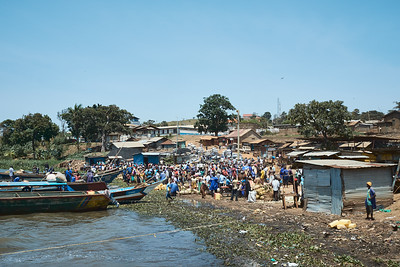 Traders from nearby islands arrive at Masese Port on market day to trade goods.