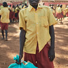 A student preparing to dispose of a bag of garbage collected from the playing field before a netball game.  Garbage is usually tossed on the ground as soon as it's no longer needed.  X-SUBA is trying to change this attitude starting with the youth, hoping it spreads to the adults.