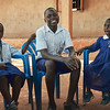 Children in X-SUBA's Sponsorship Program meet with the program manager a few times a week to discuss their progress and current issues.  Moses (center) is a product of X-SUBA's Learning Center and is now number one in his primary school class thanks to the sponsorship program.