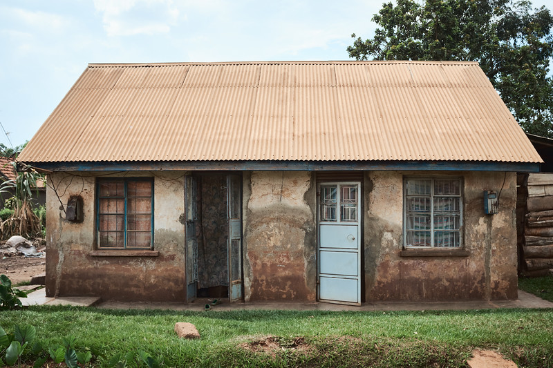 This cottage is typical of the ones constructed for factory workers in the mid-20th century.  It was a prosperous time for Walukuba.  Families continued to live here after Idi Amin shut down the factories in the 1970s because they had nowhere else to go, but jobs were gone.  Economic recovery has been extremely slow and is ongoing.