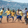Boys playing a pickup game of soccer at one of the schools in Walukuba, Uganda.  Their playtime at school is often unorganized and lacks any kind of equipment, but X-SUBA Sport4Development provides bibs, soccer balls, and coaches as they visit a different school each day of the week.