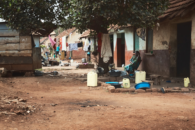 One of the neighborhoods in Walukuba.  The yellow jugs - old oil jugs - are used to carry water.  Most houses don't have running water so they need to purchase water at nearby spiogots, where they can spend as much as a quarter of their daily earnings on water.