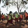 Students playing a game of netball with a soccer ball at one of the local schools during an X-SUBA visit.  The schools don't have proper coaches or equipment for the students' playtime.  X-SUBA rotates through different schools throughout the week to provide this.