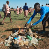 Coach Jay Jay burns a pile of trash that the children collected from the field before playing soccer and netball.  Burning trash isn't the ideal way to dispose of trash, but it's the best option in these impoverished communities.