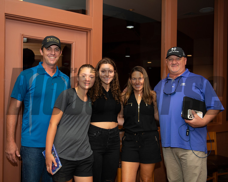 (L-R): Craig Brogden, Ella Schoenborn, Isabelle Brogden, Sherri and Kenny McPeek. Hip 315 filly by Sharp Azteca out of Triple Cream at Machmer Hall Sales<br /> Scenes, people and horses at The July Sale at Fasig-Tipton near Lexington, Ky. on July 13, 2021.
