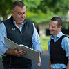 (L-R): agent Frank Lyons and Julien Leparoux looking over and discussing their book of horses. Julien Leparoux at Keeneland  on June 10, 2021.