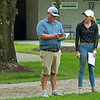 Katelyn Jackson, Elite Sales' sales director, right, talks with Conor Foley. <br /> Scenes, people and horses at The July Sale at Fasig-Tipton near Lexington, Ky. on July 10, 2021.
