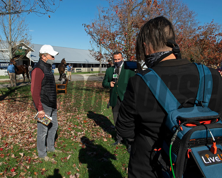 Buyer Larry Best, left, with Scott Hazelton and TVG. Hip 266 colt by Mastery out of Go Go Dana from Threave Main and breeders Eric Buckley and Lee MacMillan<br /> Sales horses at the Keeneland November Sale at Keeneland in Lexington, Ky. on November 10, 2020.