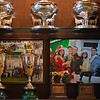 (L-r): Trophy cabinet at WinStar includes Super Saver Kentucky Derby trophy, Justify Kentucky Derby trophy, Justify Horse of the Year Eclipse award, and Justify 3yo champion eclipse., with Super Saver and Justify celebratory winner's circle photos in background. <br /> Kentucky Derby trophies for Super Saver and Triple Crown winner Justify at WinStar Farm on March 5, 2021.