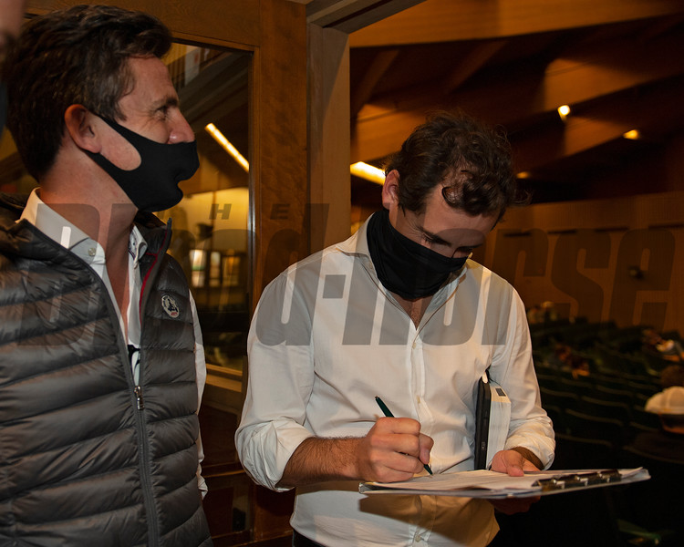 (L-R): Henri Bozo and Arthur Hoyeau signing ticket for Hip 391 Pollara from Claiborne Farm, agent<br /> Sales horses at the Keeneland November Sale at Keeneland in Lexington, Ky. on November 10, 2020.