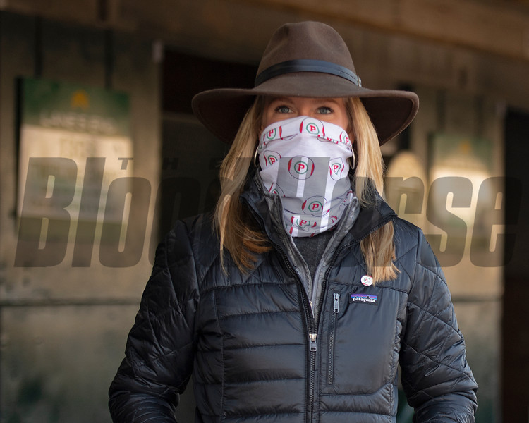Allaire Ryan, in a mask representing the Pompa dispersal through Lane's End.<br /> Keeneland January Sales at Keeneland near Lexington, Ky., on Jan. 13, 2021.