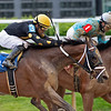 Luis Saez on #3 Jail House Code in the second race.<br /> Kentucky Derby and Oaks horses, people and scenes at Churchill Downs in Louisville, Ky., on April 24, 2021.