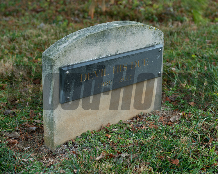 Cemetery with Devil His Due, a headstone at Margaux near Midway, Ky., on Dec. 18, 2020.