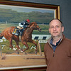 (L-R): Michael Behrens with MyRaceHorse.com in front of Easy Goer painting at the Jockey Club offices in Lexington, Ky., on Dec. 2, 2020.