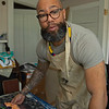 in his studio.<br /> Dafri aka Jason Thompson, an American artist from Kentucky who specializes in multi-mediums and various subjects including a focus on black jockeys and history, in his art studio on March 2, 2021.