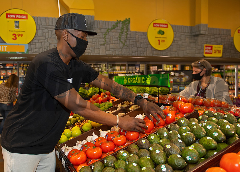 Ramel Bradley looks over the display. <br /> AppHarvest tomatoes at the Kroger Beaumont Marketplace in Lexington, Ky., on March 23, 2021.