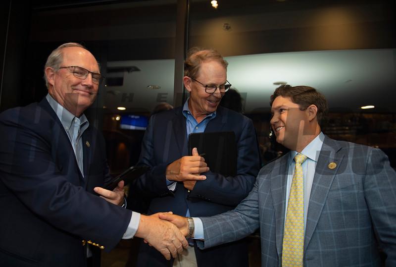 (L-R): David Hanley, Elliott Walden and Conrad Bandoroff<br /> Sales scenes at Fasig-Tipton in Saratoga Springs, N.Y. on Aug. 9, 2021.