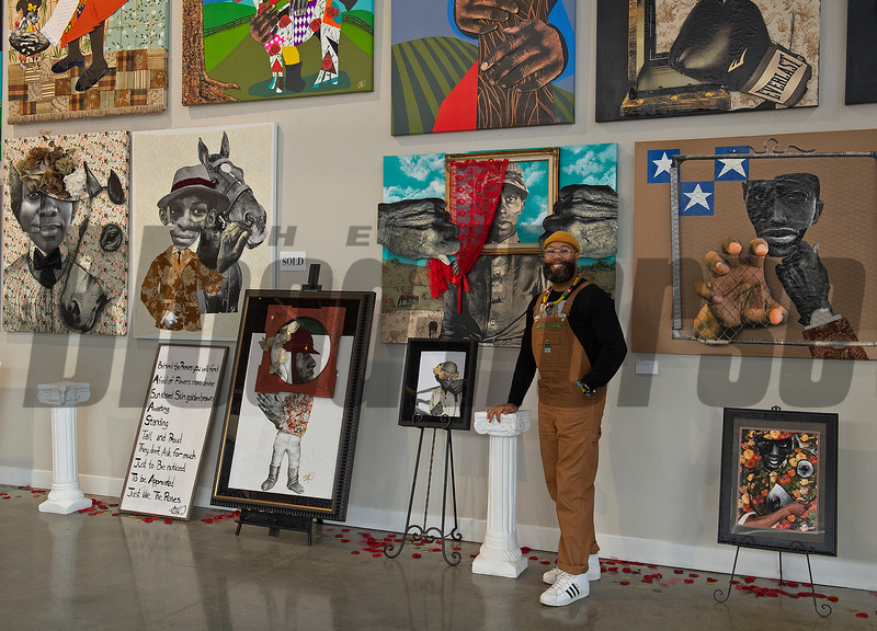 Standing by his gallery display with Hidden Flowers (lower right acquired for the Kentucky Derby Museum) and Behind the Roses (red lace). <br /> Dafri, an American artist, at Greyline where his artwork is displayed and sold in Lexington, Ky. on March 11, 2021.