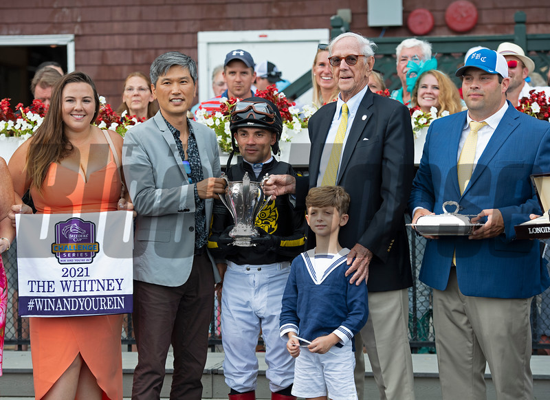(L-R): Whitney Girl, Korea Authority rep, Joel Rosario, Leverett Miller and grandson Royal Douglass, Brad Cox. Knicks Go with Joel Rosario wins the Whitney (G1). <br /> Saratoga racing scenes at Saratoga in Saratoga Springs, N.Y. on Aug. 7, 2021.