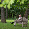 Ted Bassett in his garden and under the trees on Lanark Farm near Versailles, Ky. on July 7, 2021.