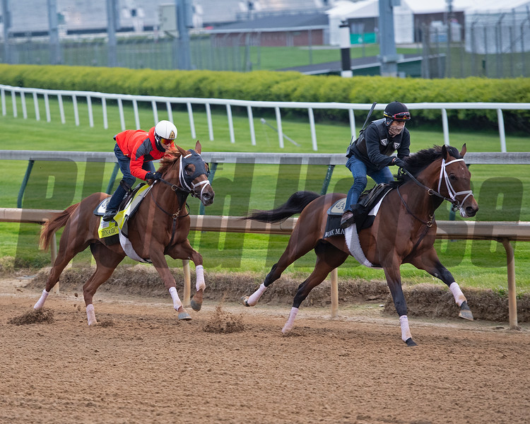 Dynamic One, left, starts his work behind his workmate.<br /> Kentucky Derby and Oaks horses, people and scenes at Churchill Downs in Louisville, Ky., on April 23, 2021.