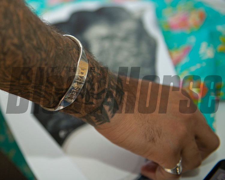 closeup of bracelet with DAFRI's name<br /> Dafri aka Jason Thompson, an American artist from Kentucky who specializes in multi-mediums and various subjects including a focus on black jockeys and history, in his art studio on March 2, 2021.