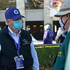 Billy Fryer with BC equine security talks with Keeneland personnel manning the saddling area and paddock<br /> Breeders' Cup horses at Keeneland in Lexington, Ky. on November 6, 2020.