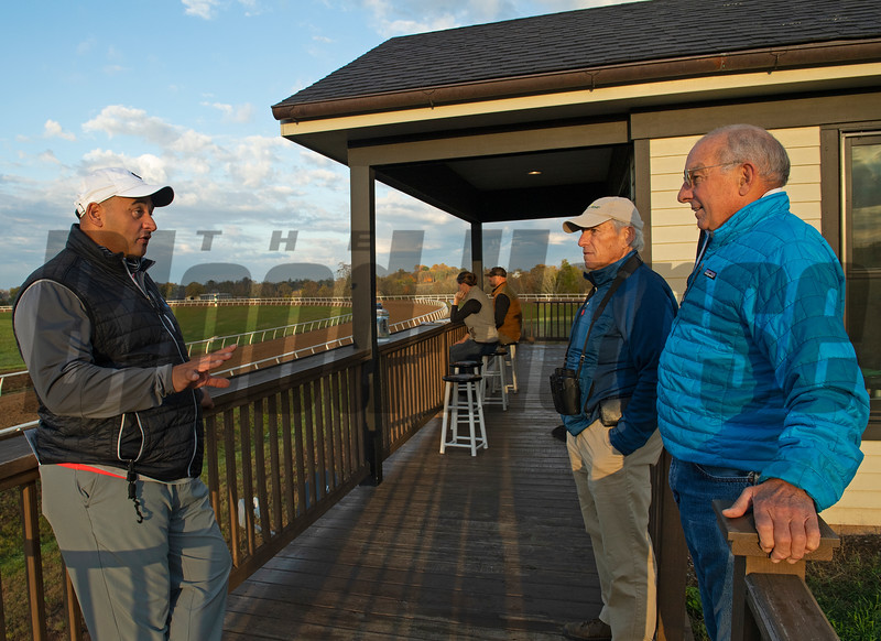 Robbie Medina, left, talks with Steve Shahinian, 2nd left, and Jeff Morris, right. Katey Caddel and Guiness McFadden in background on stools. Robbie Medina training horses at Blackwood Stables near Versailles, Ky.  on October 22, 2020.