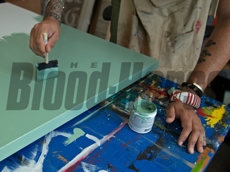 painting<br /> Dafri aka Jason Thompson, an American artist from Kentucky who specializes in multi-mediums and various subjects including a focus on black jockeys and history, in his art studio on March 2, 2021.