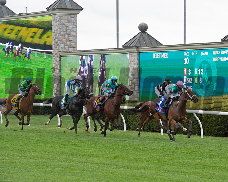 First time by with Juliet Foxtrot on the lead. Juliet Foxtrot with Tyler Gaffalione wins the Coolmore Jenny Wiley (G1)<br /> at Keeneland near Lexington, Ky., on April 10, 2021.