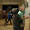 Caption: Eating breakfast and Reviewing and making adjustments and adding information using color coded markers to the sets.<br /> A native of Oklahoma, Heath started working at WinStar Farm on October 10, 2014, and became the farm trainer in October of 2018. Presently he has about 100 horses in training at the WinStar Farm training center, where they have a 7 1/2-furlong main track and 3/4 of a mile undulating turf gallop.<br /> Daily Life series on Destin Heath, farm trainer at WinStar Farm on Aug. 11, 2020 WinStar Farm in Versailles, KY.