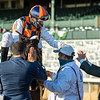 Alberto Figueiredo pats the head of Ivar as Joe Talamo celebrates with trainer Paulo Lobo after winning the Shadwell Turf Mile (G1) at Keeneland on October 3, 2020.