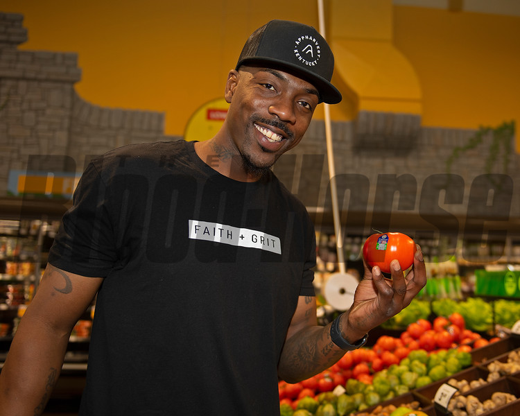 Ramel Bradley, Community Director for AppHarvest, holds up one of their products. <br /> AppHarvest tomatoes at the Kroger Beaumont Marketplace in Lexington, Ky., on March 23, 2021.