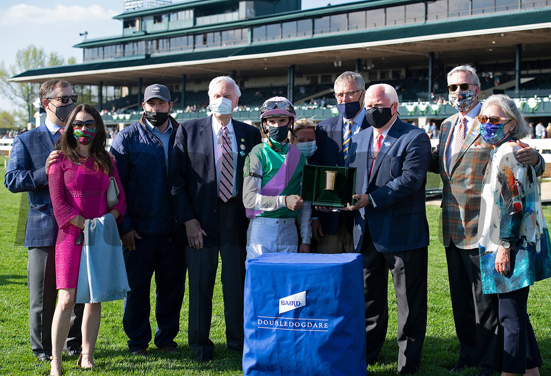 Presentation includes presenters Jim Allen, Steve Grossman, and Tom Kessinger as well as trainer Brad Cox (3rd left), John Chandler (4th left), jockey Florent Geroux, and Garrett O'Rourke (glasses, 4th from right). Bonny South with Florent Geroux wins the Baird Doubledogdare (G3) at Keeneland near Lexington, Ky., on April 16, 2021. .