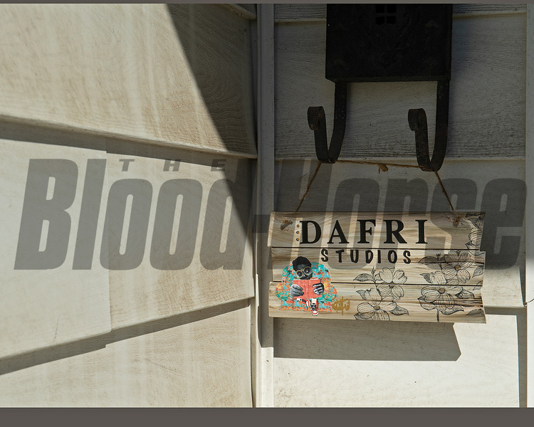 studio sign hangs from mailbox<br /> Dafri aka Jason Thompson, an American artist from Kentucky who specializes in multi-mediums and various subjects including a focus on black jockeys and history, in his art studio on March 2, 2021.