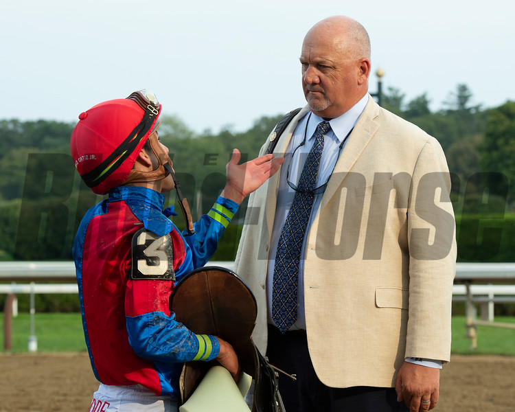 (L-R): Irad Ortiz Jr. talks with Kenny McPeek after Swiss Skydiver's run in the Whitney (G1). <br /> Saratoga racing scenes at Saratoga in Saratoga Springs, N.Y. on Aug. 7, 2021.