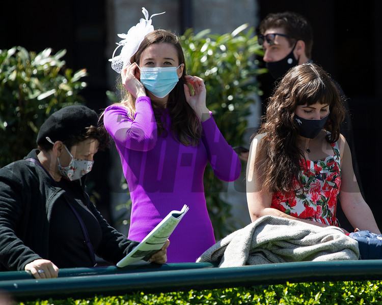 Scenes: putting on her mask<br /> at Keeneland near Lexington, Ky., on April 3, 2021.