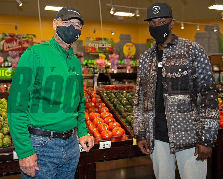 (L-r): Harold Webb and Ramel Bradley with AppHarvest in front of tomato display. <br /> AppHarvest tomatoes at the Kroger Beaumont Marketplace in Lexington, Ky., on March 23, 2021.