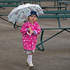 Fashionable young patron at Keeneland making the most of a rainy day<br /> at Keeneland near Lexington, Ky., on April 10, 2021.