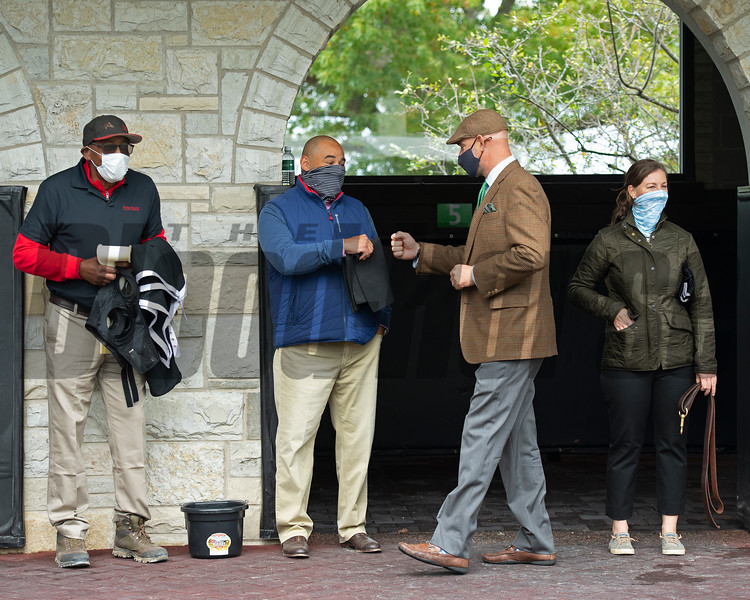 (L-R): The training team, Julio Gondola, Robbie Medina, Guiness McFadden, and Katey Caddel, at Keeneland. Robbie Medina saddles and watches #5 Bakers Bay with Tyler Gaffalione in allowance Race 5  at Keeneland on October 18, 2020.