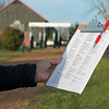 Richard Budge holds the day's training set list at Jim and Susan Hill's Margaux Farm near Midway, Ky., on Dec. 8, 2020.