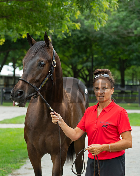 Tanya Johnson shows Hip 202 yealring colt from her Red Gables Stud consignment. <br /> Scenes, people and horses at The July Sale at Fasig-Tipton near Lexington, Ky. on July 10, 2021.