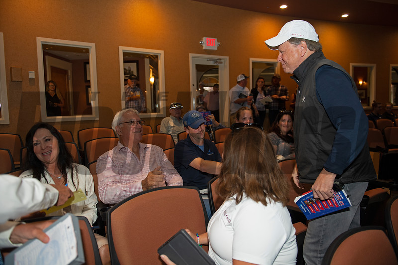 (L-R): Dana and Jim Bishop, and advisor Matt Weinman, Katie Taylor (back to camera in white shirt), and Larry Best (standing/white cap) after sale of Hip 111 colt Candy Ride out of Beyond Grace from Taylor Made, agent.<br /> Scenes, people and horses at The July Sale at Fasig-Tipton near Lexington, Ky. on July 13, 2021.